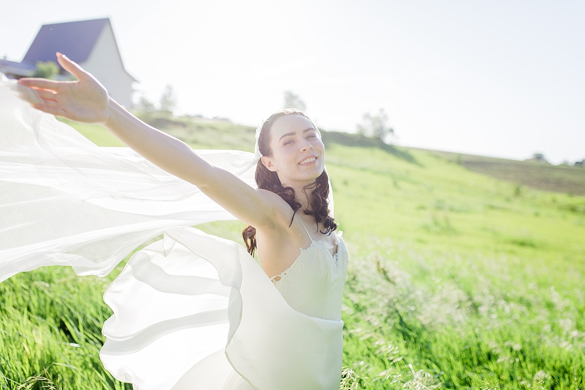 Bride in a open field at a Rising Tide Society Styled Shoot