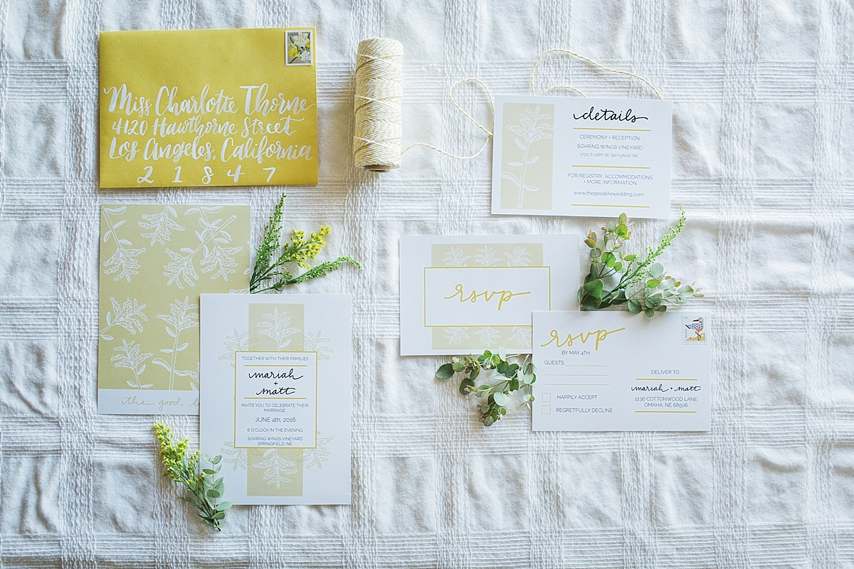 Yellow and white stationery suite for a wedding invite
